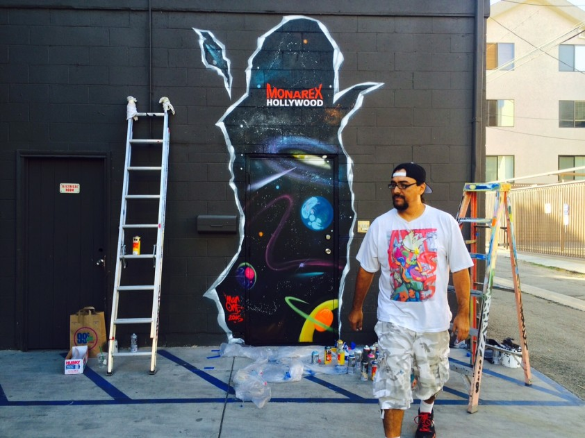 Man One paints Monarex logo